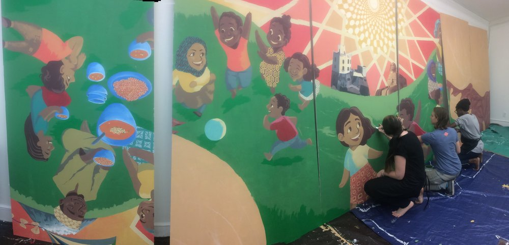 Team Wildcat working on their section of the Whittier Mural