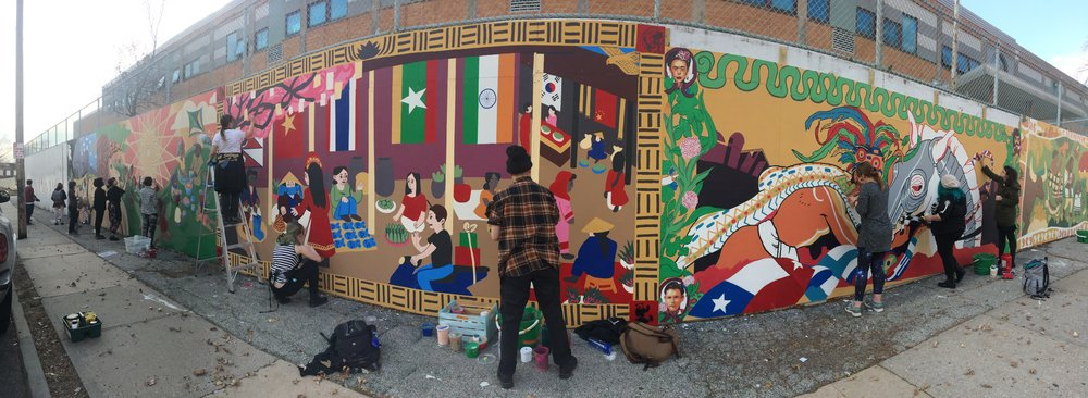 KCAI juniors touching up the mural after installation