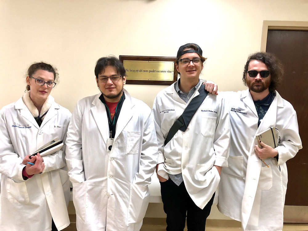 Everyone that enters the classroom lab is required to wear a lab coat. KCAI Illustration seniors Kaitlyn Jordan, Jose Leal, Miles Klos and Jesse Bonniwell are ready to draw!