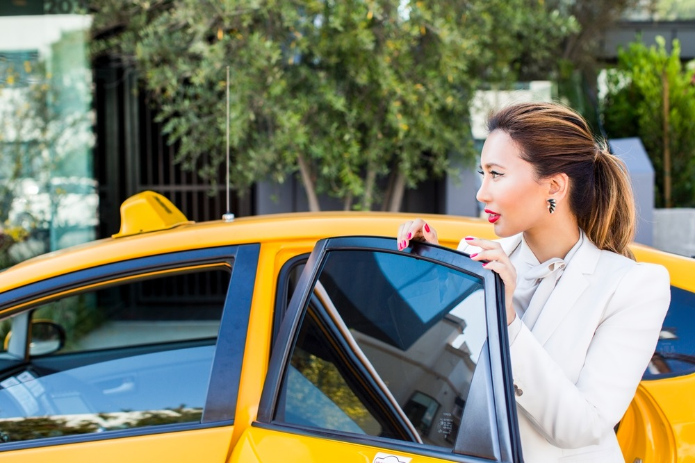 Fashionable-Woman-Taking-Taxi.jpg