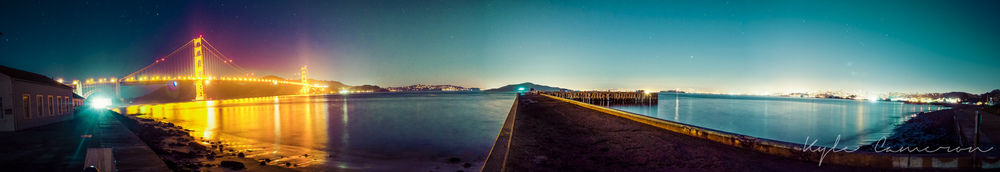Long exposure panorama of the San Francisco Bay at night.