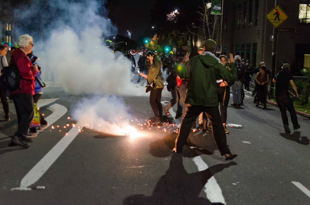 More smoke, gas or just a sparkler to induce panic fired near Police Station on December 6th - photo by Kyle Cameron