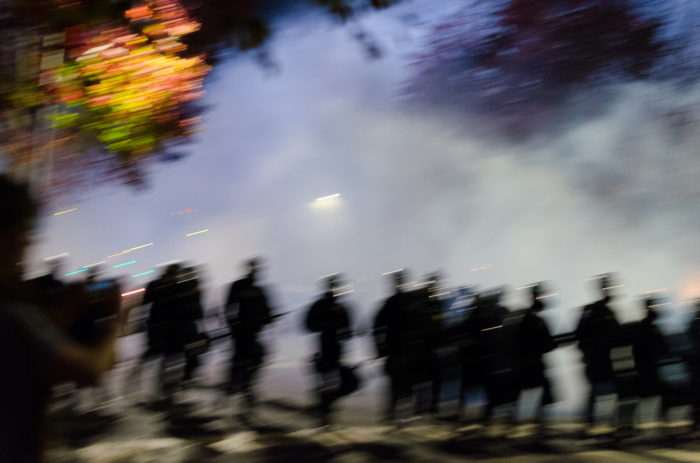 The photo at the top of this post is from the tear gassing. This ended up being a more abstract view of the tear gassing. Those are the people who are supposed to protect and serve you. Does this image make you feel safe? Are those peace officers there, or are they terrorists who just fired chemical weapons that are banned in war on a crowd of peaceful protesters? - photo by Kyle Cameron