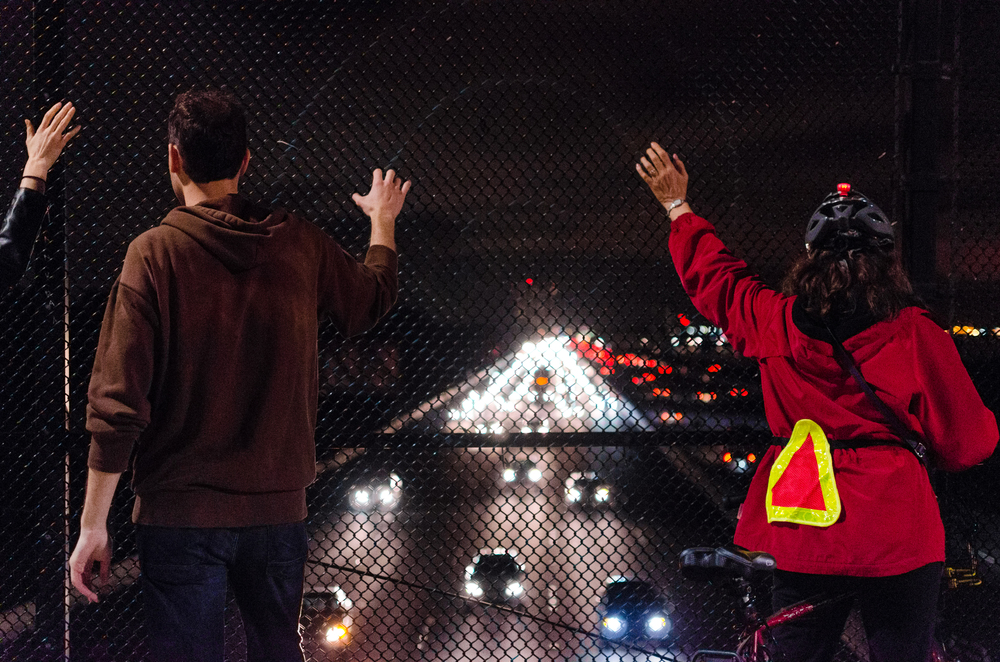 Protesters on pedestrian bridge over I-80 in Berkeley, CA observing the slowed traffic on the night of December 8th, 2014 - photo by Kyle Cameron