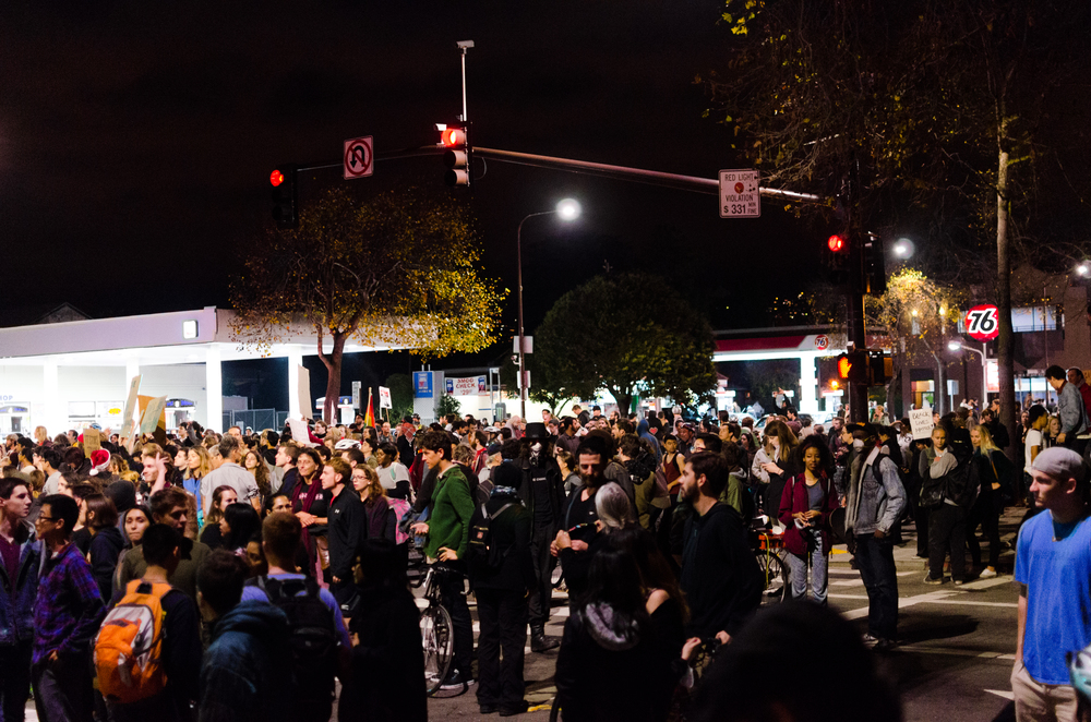 Some of the crowd gathered at University and 6th street in Berkeley being blocked from the bridge by a police line - photo by Kyle Cameron