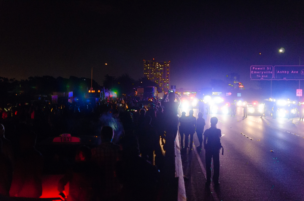 Demonstrators march down both lanes of Interstate 80 in Emeryville, CA on December 8th, 2014 - photo by Kyle Cameron