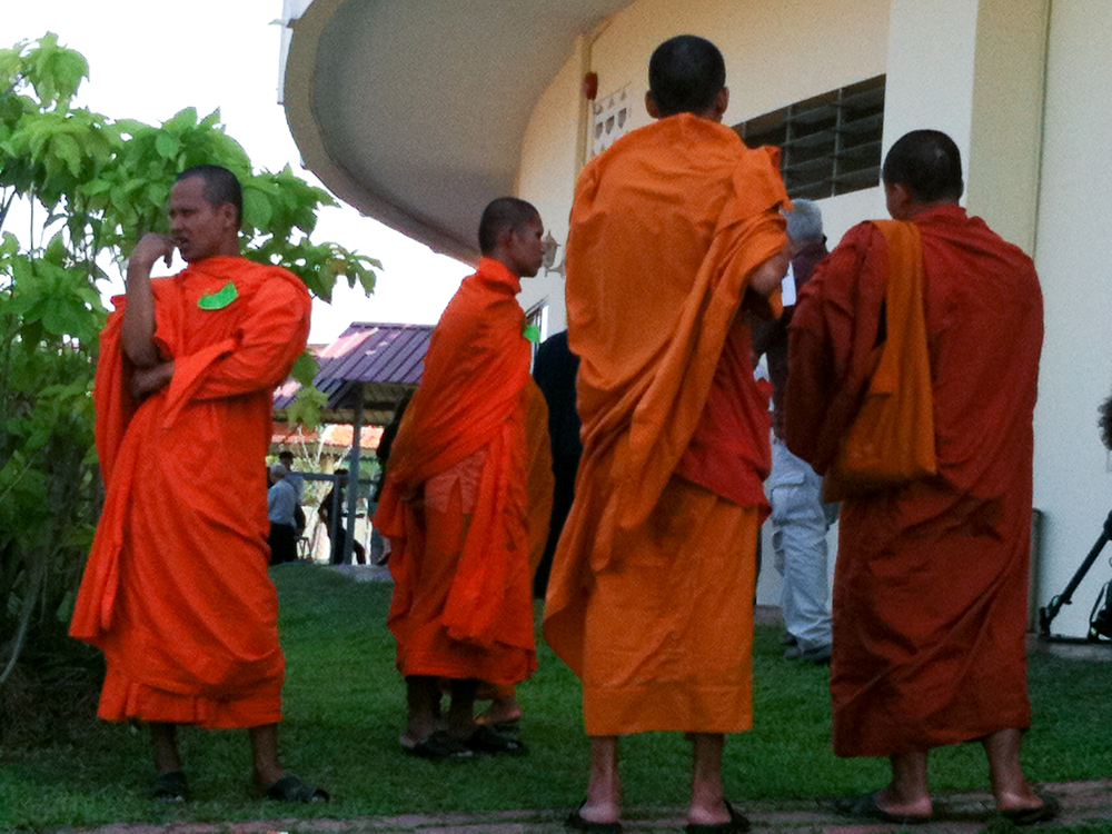 Monks stand outside the Khmer Rouge tribunal courtroom in Phnom Penh.