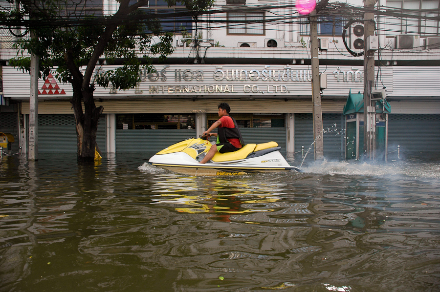 Residents in a flooded Bangkok neighborhood found different methods of transportation.
