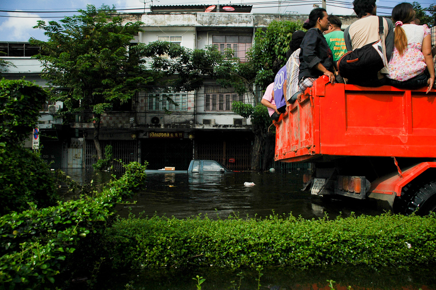 Residents leave a flooded Bangkok neighborhood by truck.