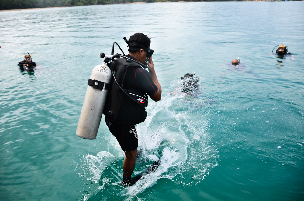 A recruit jumps into the water. Potential members of Cambodia's first underwater UXO salvage team will undergo months of training.