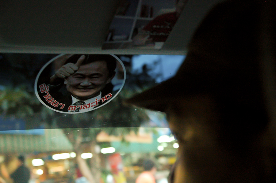 The face of ousted former Thai Prime Minister Thaksin Shinawatra is seen on a car decal driven by a Red Shirt organizer in Chiang Mai, Thailand.