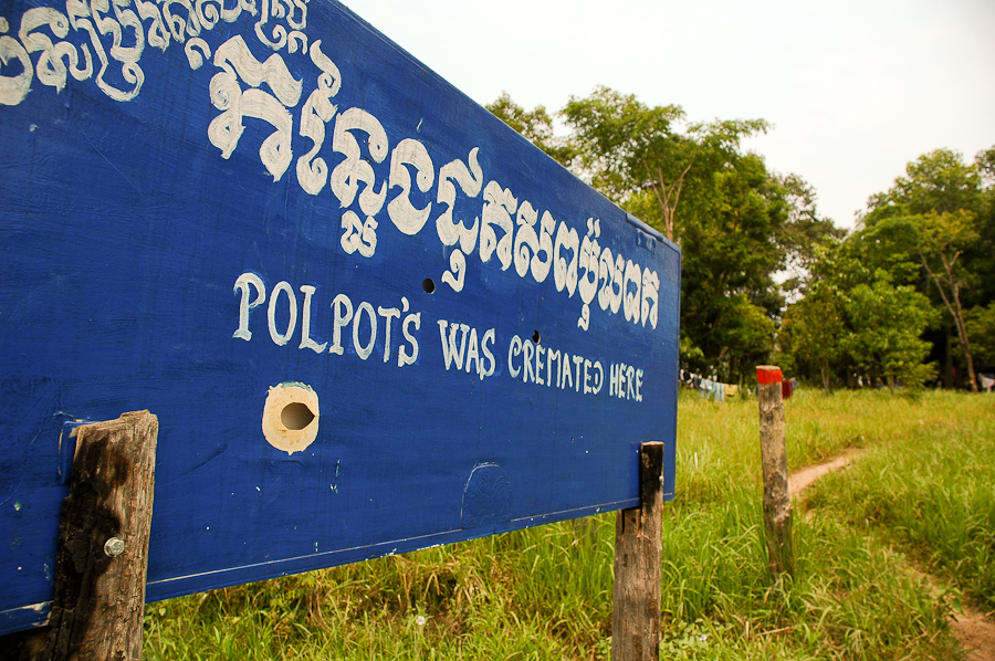 A road sign marks the location of Pol Pot's grave, near Anlong Veng, Cambodia.