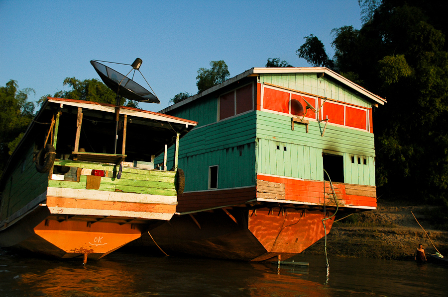 Boats along the Mekong River as sunset approaches, near Luang Prabang, Laos.