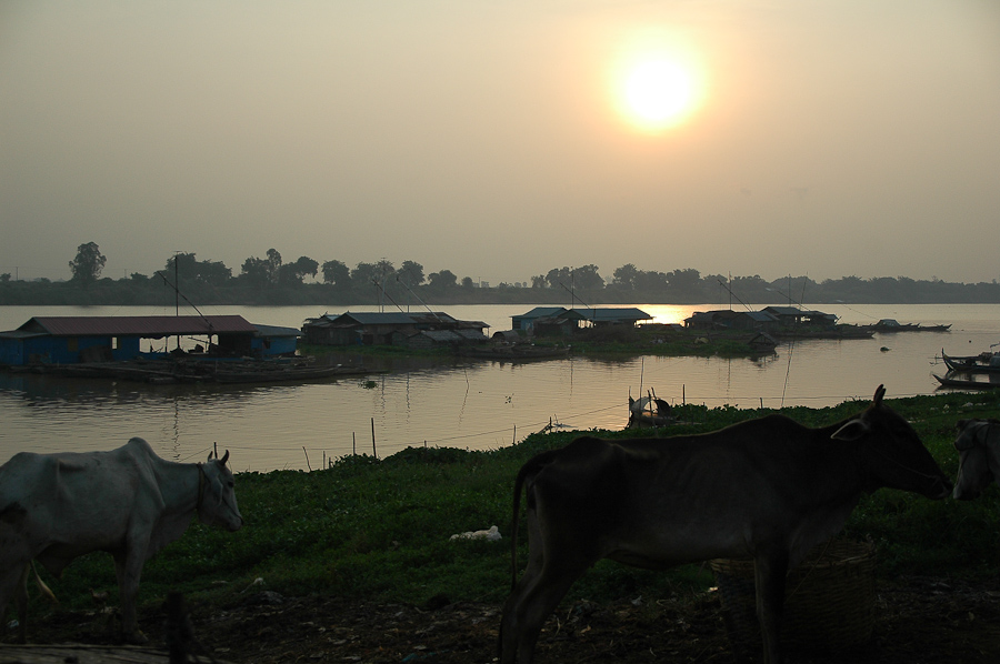 A view of sunrise over the Tonle Sap River, a Mekong tributary, from a fishing village near Phnom Penh.