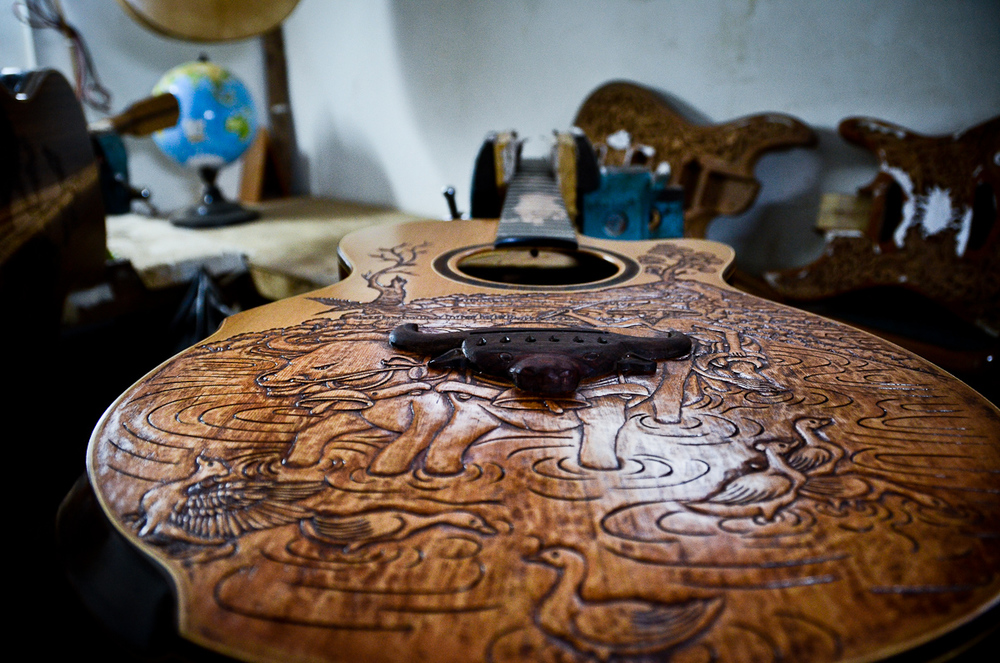 A guitar in Wayan Tuges's Bali guitar workshop nears completion.