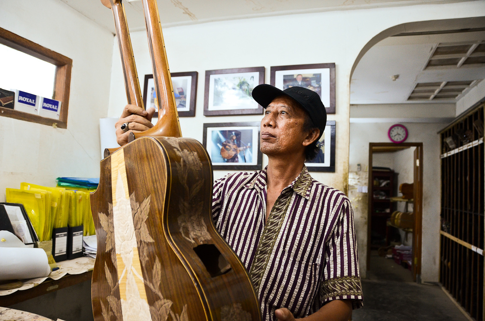 Wayan Tuges inspects an early prototype of a new guitar model: a double-necked acoustic/electric hybrid.