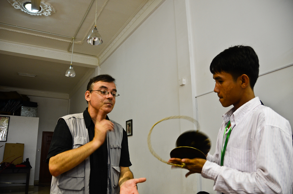 Patrick Kersalé, left, works with a musician at the Cambodian Living Arts rehearsal studio in Phnom Penh.