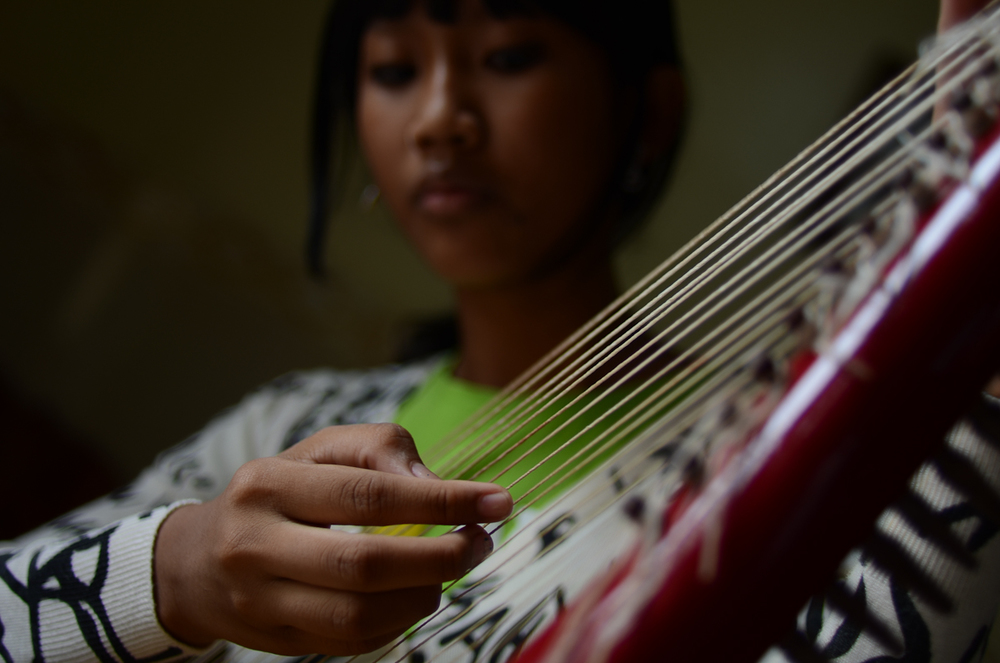 Snguon Kavei Sereyroth plays the harp at her home in Phnom Penh.