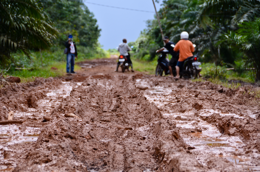 The only road leading to Adrianus' village is muddy and at times impassable during the rainy season.