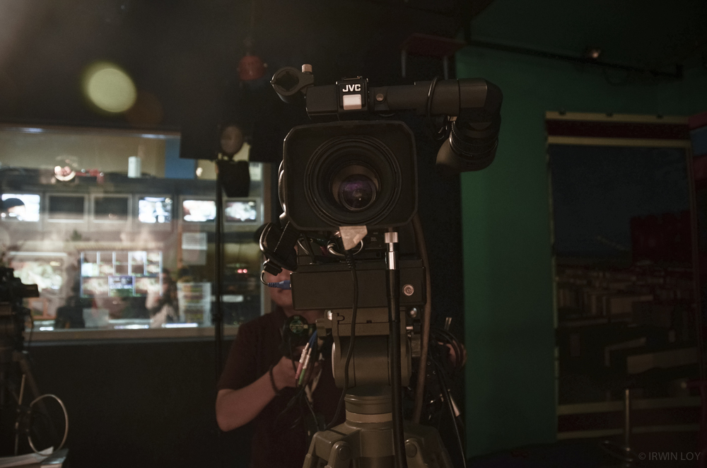 A camera operator gets ready to film the evening newscast at RuaiTV, a community TV station in Pontianak, West Kalimantan.