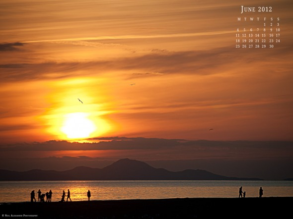 Kids playing in the setting sun on the beach at Barmouth - Desktop Wallpaper for June 2012