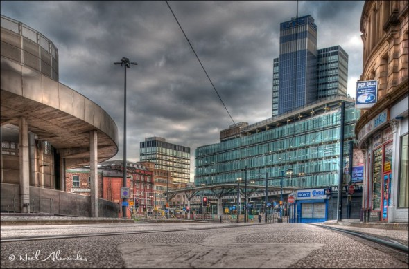 Looking down High Street Manchester towards Shudehill bus and Metrolink station with the CIS Tower in the background (Click for larger)