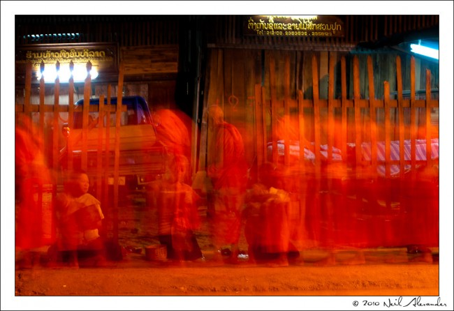 Long exposure shot of Monks in Luang Prabang by Neil Alexander
