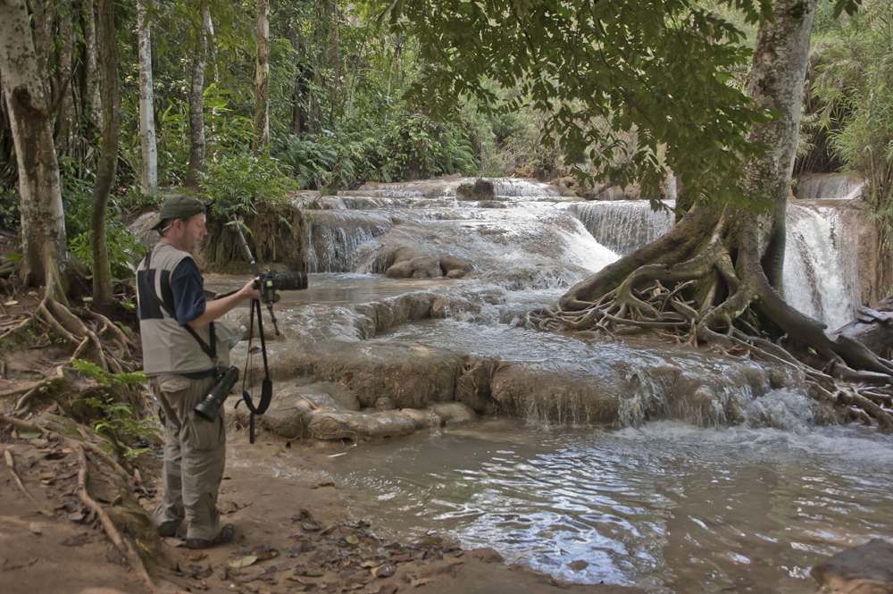 N eil Alexander in Laos sporting a fine line in Hasselblad photography vests...