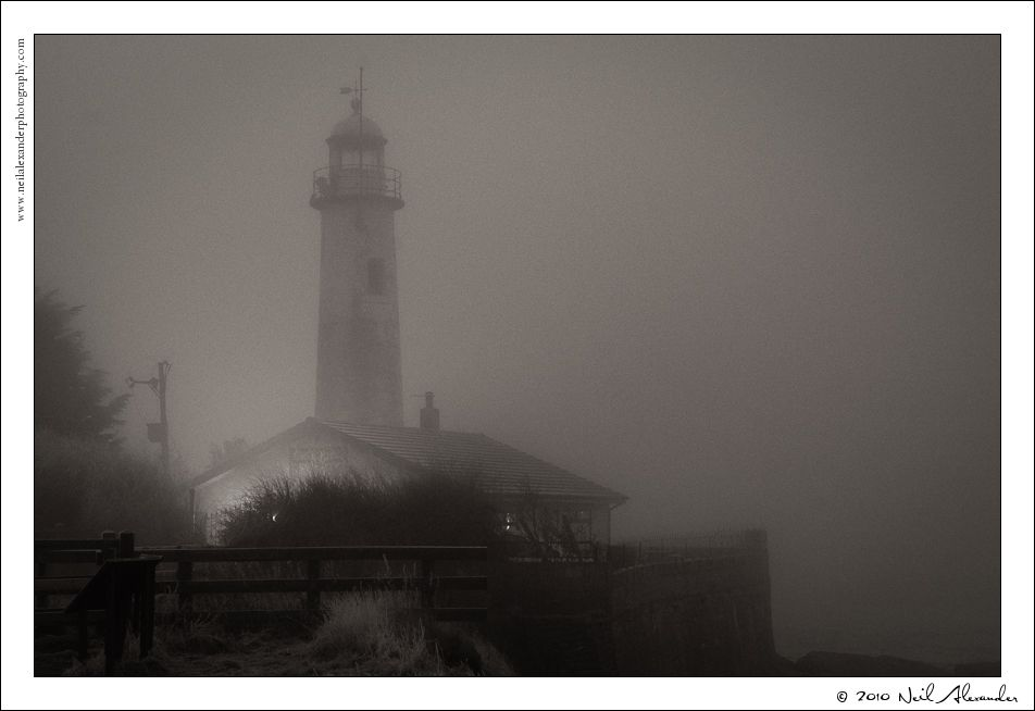 Hale Head Lighthouse in the fog by Neil Alexander