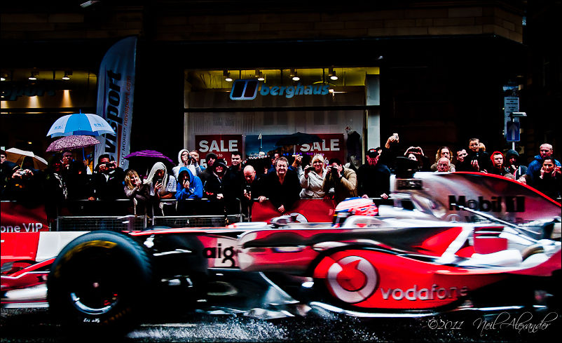 Jenson Button in his McLaren Mercedes tears up Deansgate, Manchester