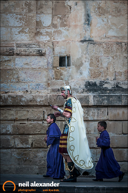 A Roman centurion on his way to the Easter parade in Zejtun, Malta with his boys