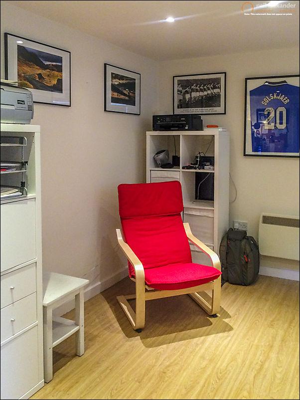 Precision hung photos in the new office along with my prized signed Ole Gunnar shirt which follows me everywhere. And a big space waiting to be filled.