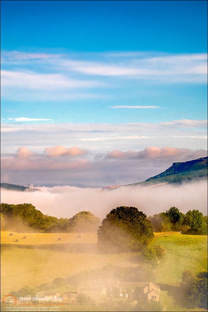 Misty sunrise over the Derwent Valley looking towards Hallam Moors in the High Peaks