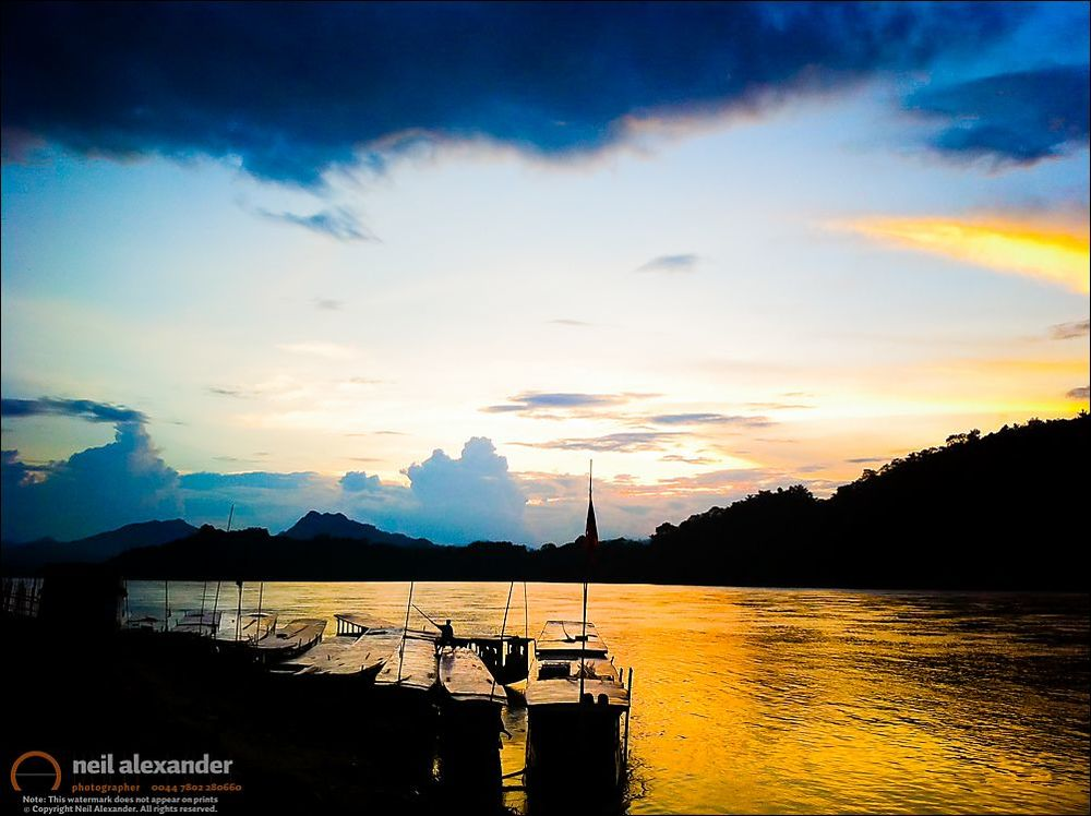 Boats in the Mekong River, Luang Prabang at sunset