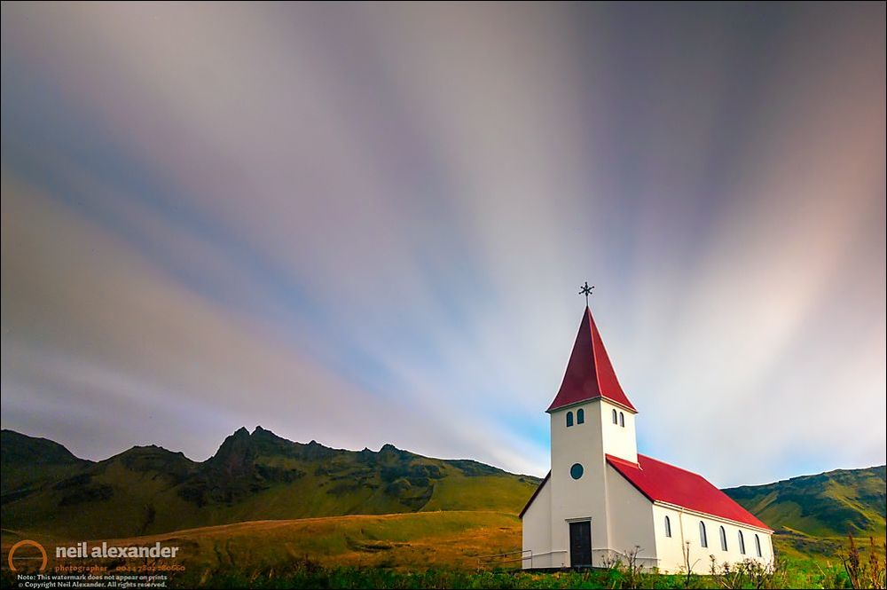 A 5 minute exposure of first light over the church at Vik in Iceland