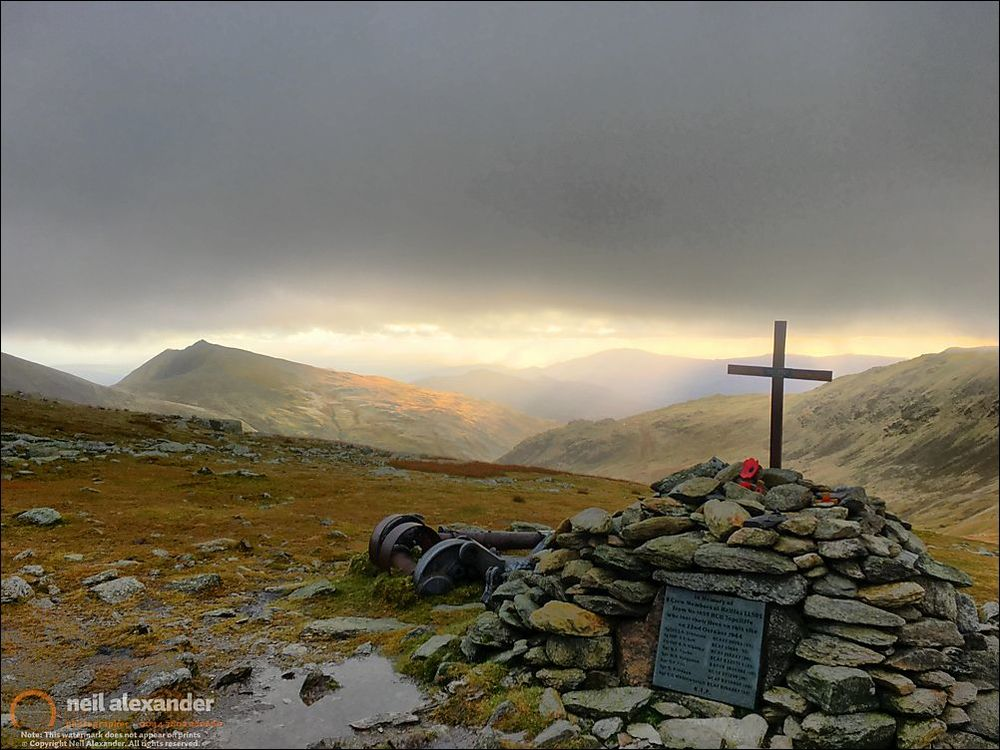 Great Carrs Air Crash Memorial Halifax LL505 came to grief on Great Carrs in the Lake District on the night of 22nd October 1944 whilst on a night navigation exercise from Topcliffe in Yorkshire. Its crew; seven Canadians and one Scot, encountered very thick cloud whilst over the north-west of England, they circled the aircraft hoping the cloud would clear but this made them even more lost. The pilot then descended so the navigator could get a visual fix on the ground but by this stage it was flying too low in the heart of the Lakes. In a few seconds the aircraft hit the top of Great Carrs and crashed killing all on board. The wreckage partly caught fire but was almost intact when found by rescuers. As the RAF crash team could not remove it from the site because of its size and location it was broken into movable sized pieces and, because if left where it was then other aircraft flying overhead would report it, it was pushed off the side of the mountain into Broad Slack, where much of it remains today.