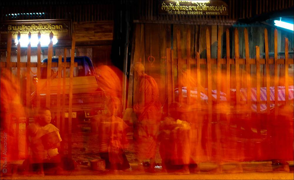 Monks collecting alms before dawn in Luang Prabang