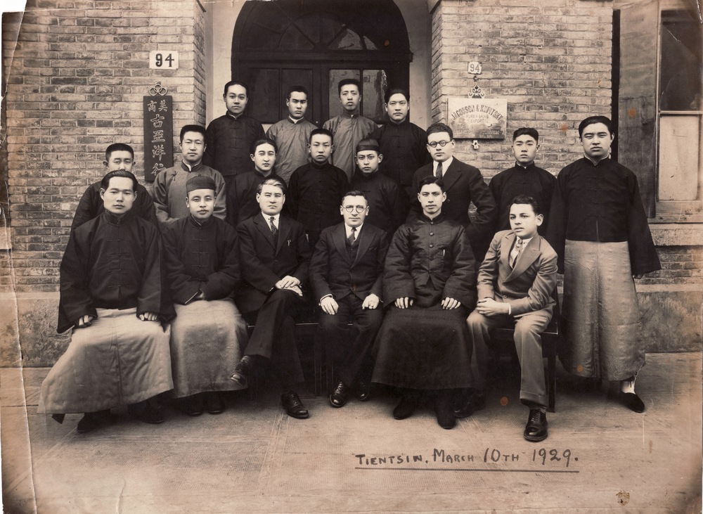 Grandpa (at bottom right with leg out) with employees of their fur trading company Jacobsen & Kupitsky in Tientsen, 1929.