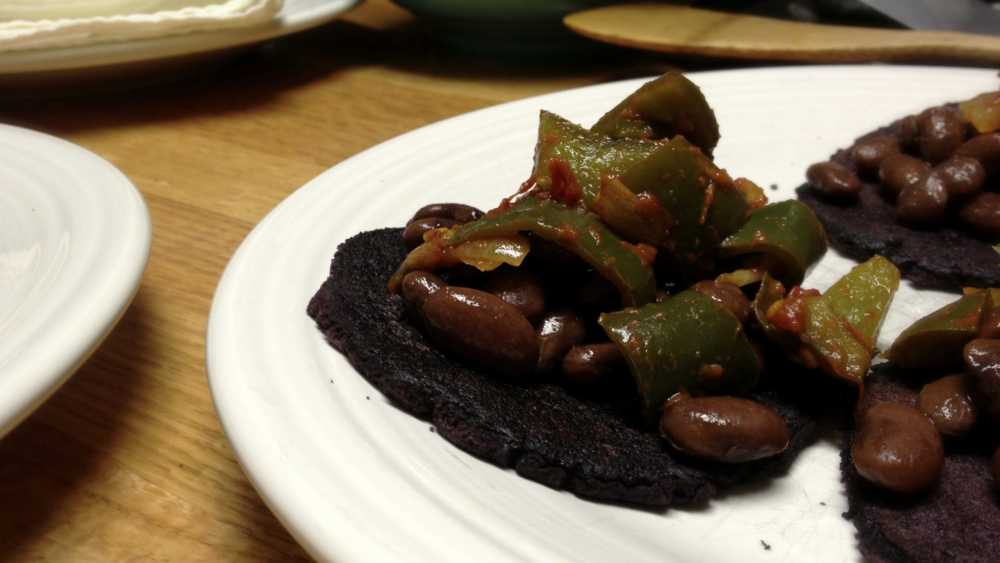 Hopi pinto beans with green chile sauce and blue corn tortillas