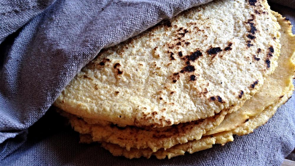 tortillas, folded in a clean kitchen towel to steam