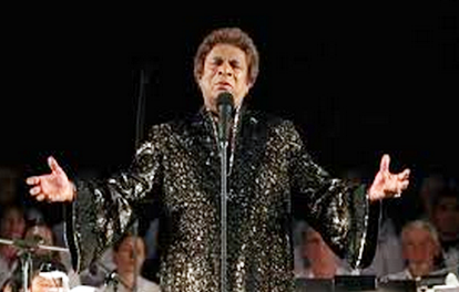Kamahl, simultaneously resplendent and terrifying in a black and gold lame caftan