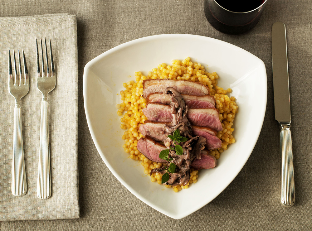 Duck. Pan seared.  Citrus Israeli Cous Cous. Wild Mushroom Ragout