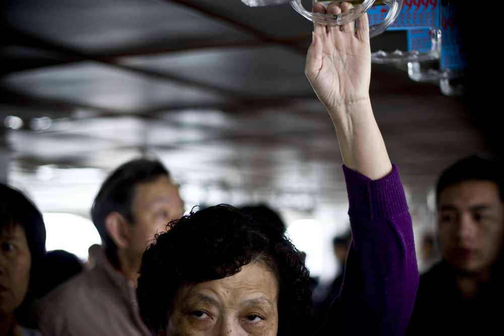 ​A commuter rides a ferry from Gulangyu Island to the mainland, Xiamen, in southern China.