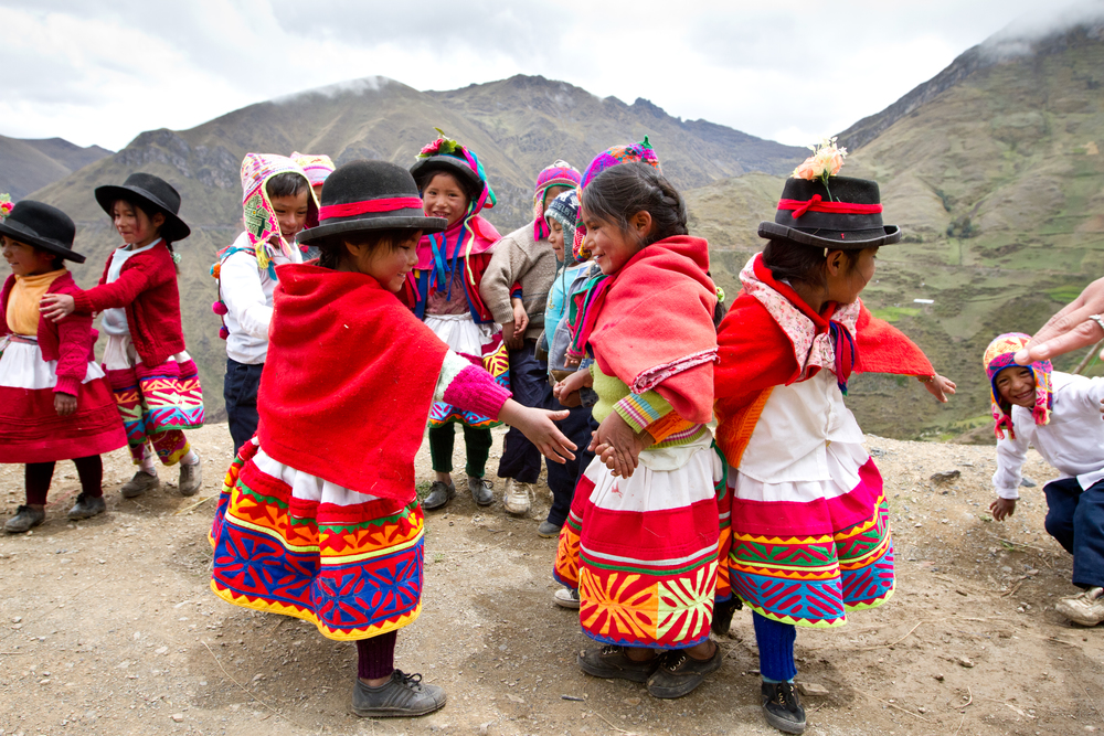 Quechua preschoolers dance and play at the edge of a mountain deep in the Andes, hours away from any city. Alpacas, sheep, and various agriculture sustain families in this remote Peruvian village.