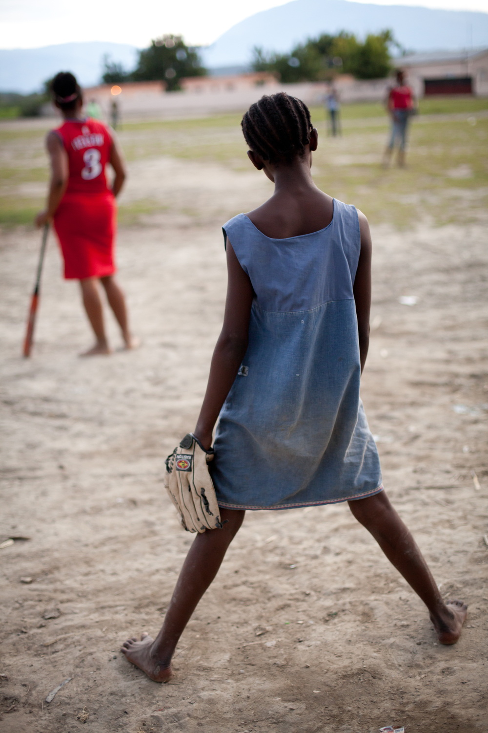 ​A girls' softball team, with players from ages 12 to 23, plays on a makeshift diamond in a sugar cane workers' shantytown in Barahona, Dominican Republic, near the border of Haiti.