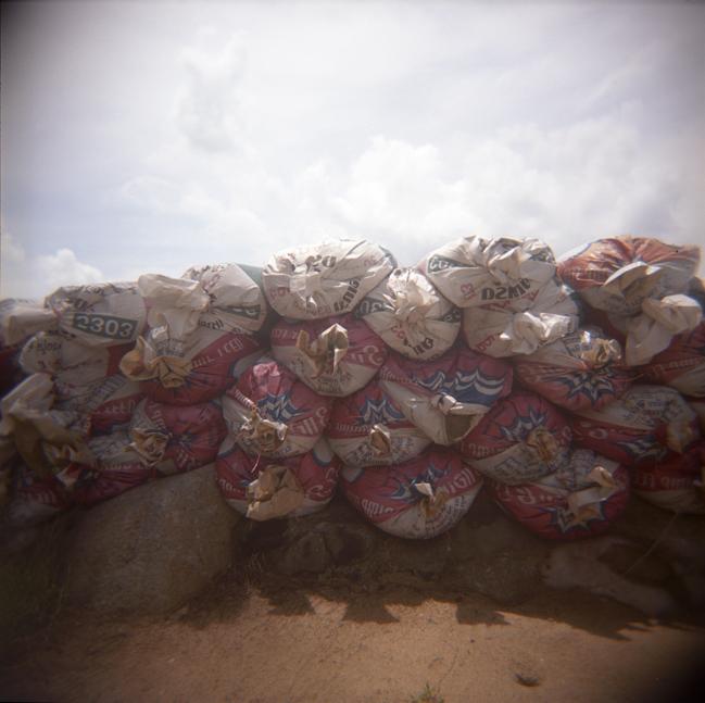 Sandbags at the edge of the Andaman Sea, Thailand. 2008.