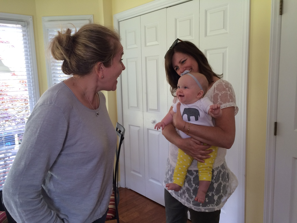 Our fantastic realtor, Isabelle, making Esther laugh in the kitchen with Mama Metty.