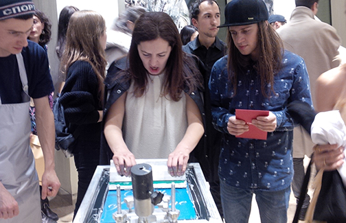 Partygoers screen printing at Visionaire party at the Tsvetnoy Moscow, Russia
