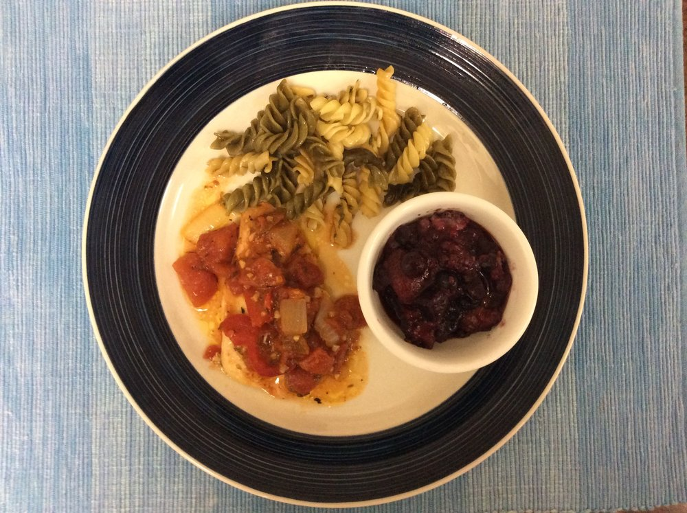 Chicken Cacciatore, tri color rotini, and mixed berry compote