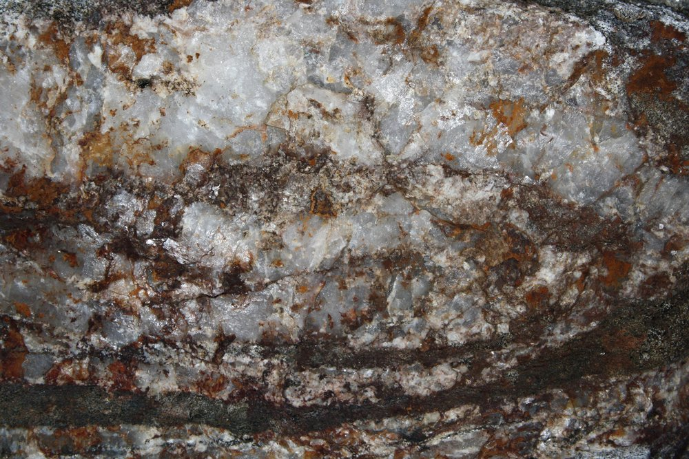 white-quartz-rock-texture-with-hematite-iron-rust-stains.jpg